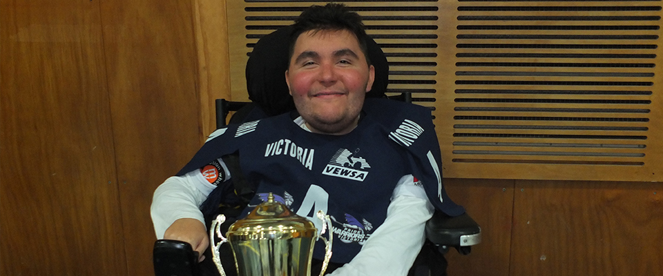 Michael celebrating after Victoria win the Powerchair Hockey championships at NEWS 2018.